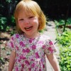 My cousin Ella (3) in her garden in Brooklyn, New York. June 5 2003.