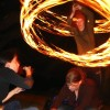 My friend Peter Farrel spinning fire poi over the head of his sister Katy. I love Katy's nonchalance, ignoring her brother's attempt to disturb her. July 2 2006.